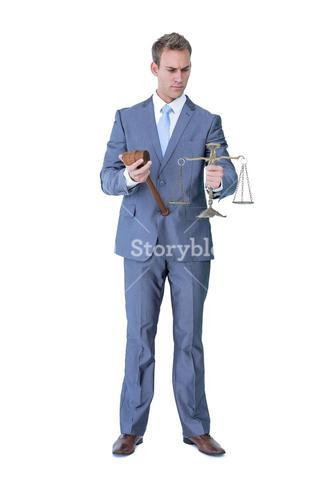 Businessman holding hammer and balance