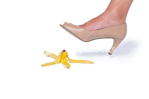 Woman with heel shoes walking on banana