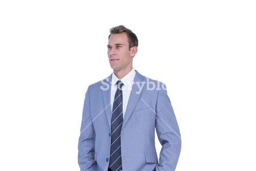 Handsome businessman standing with hands on pockets