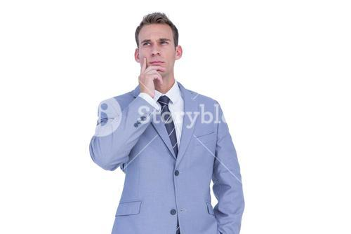 Handsome businessman thinking with finger on chin