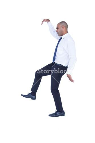 Businessman walking with arms up