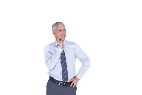 Thoughtful businessman with head on hand