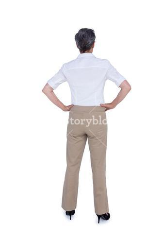 Rear view of businesswoman with hands on hips