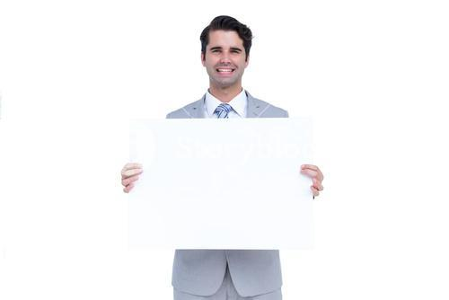Businessman holding a white sign