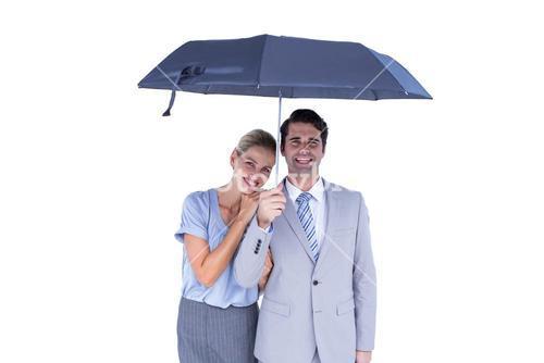 Business people holding a black umbrella
