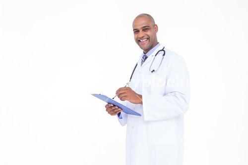 Confident doctor in white tunic writing notes