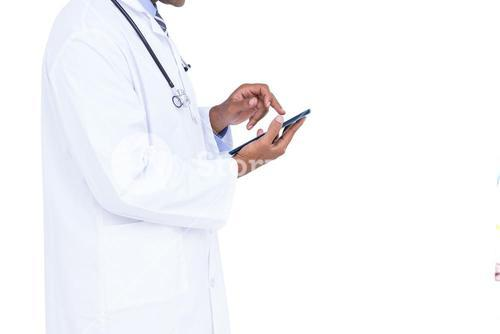 Standing doctor using tablet