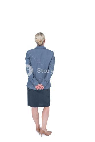 Businesswoman standing with hands behind back