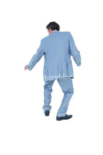 Rear view of happy businessman gesturing