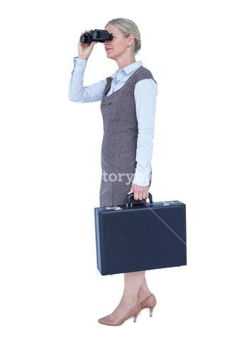 Profile of a businesswoman using a binocular