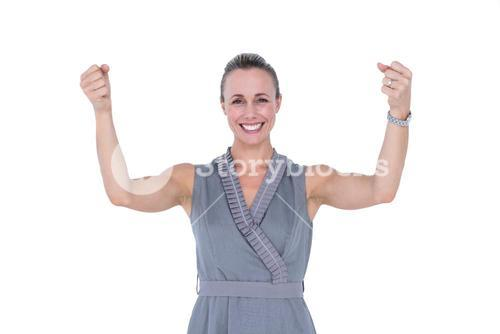 Businesswoman gesturing with raised arms