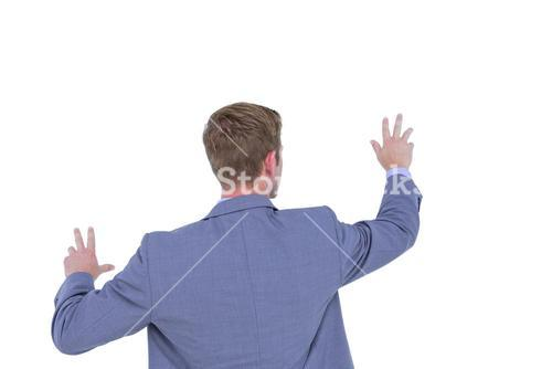 Back turned businessman gesturing with hands