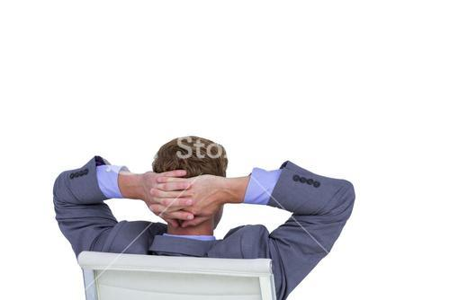 Relaxed businessman extended on a chair