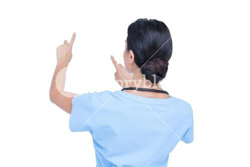 Young nurse in blue tunic gesturing with hands