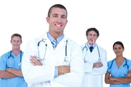 Smiling doctors and nurses standing