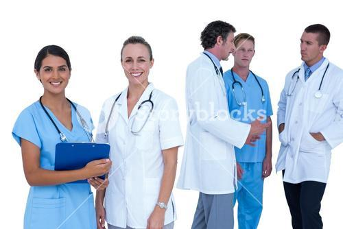 Doctors and nurses discussing over notes