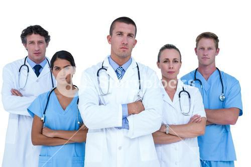 Concentrated doctors and nurses looking at the camera