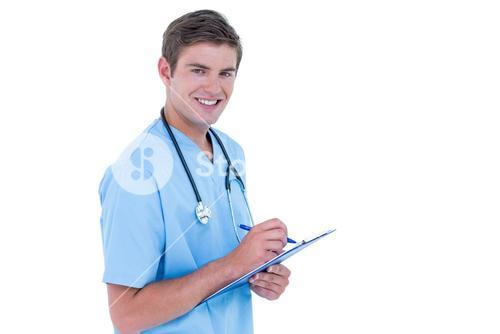 Young nurse in blue tunic writing notes