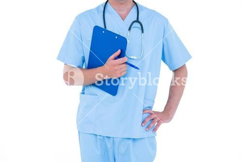 Standing young nurse in blue tunic