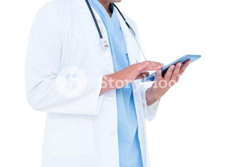 Standing doctor using his tablet
