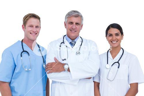 Doctors and nurse standing together