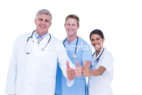 Doctors and nurse gesturing thumbs up