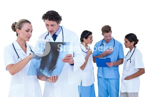 Doctors and nurses discussing over x-ray