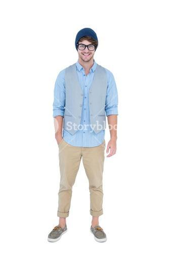 Geeky hipster looking at camera with hand in pocket