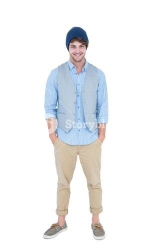 Handsome hipster with hands in pocket looking at camera