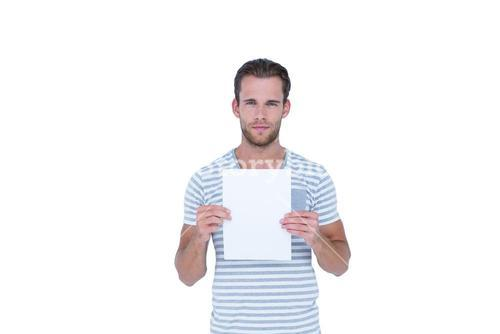 Serious handsome man holding paper