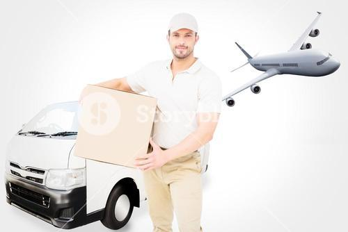 Composite image of delivery man carrying cardboard box