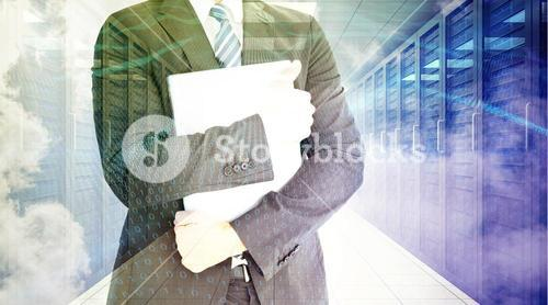 Composite image of businessman holding his laptop tightly