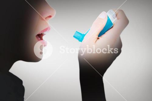Composite image of close up of a woman using an asthma inhaler