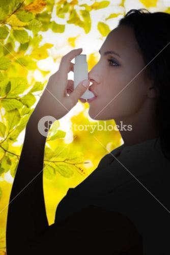 Composite image of asthmatic brunette using her inhaler