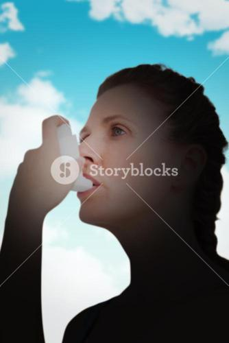 Composite image of woman using inhaler for asthma