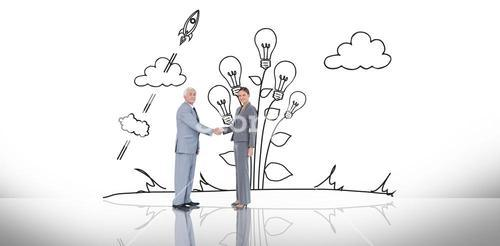 Composite image of business team shaking hands