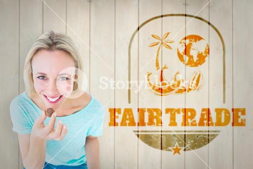 Composite image of smiling blonde holding box of chocolates