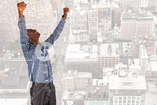 Composite image of excited businessman cheering