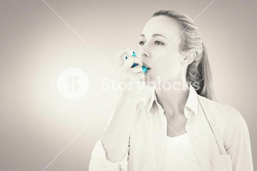 Composite image of pretty blonde using an asthma inhaler
