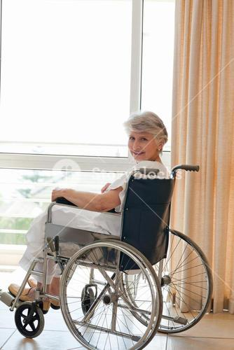 Woman in her wheelchair looking at the camera