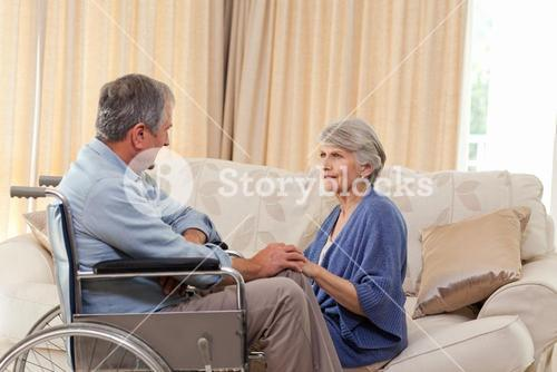 Senior couple talking in the living room at home