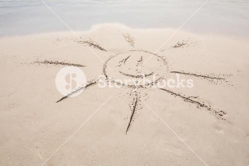 drawing of a sun in the sand