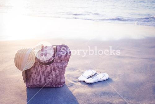 bag with sunhat and flip flop
