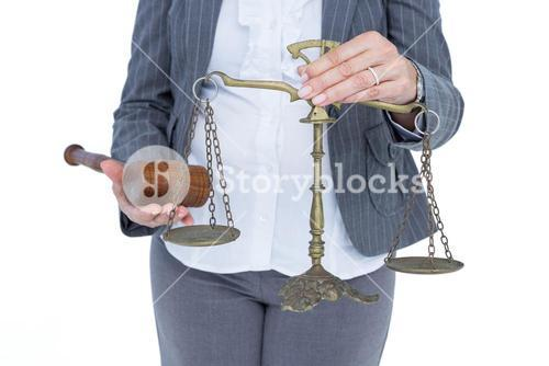 businesswoman holding scales of justice