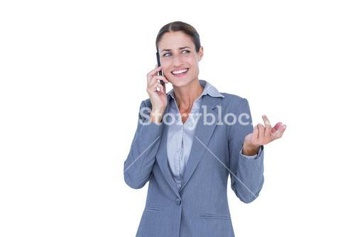 Businesswoman calling with her smartphone
