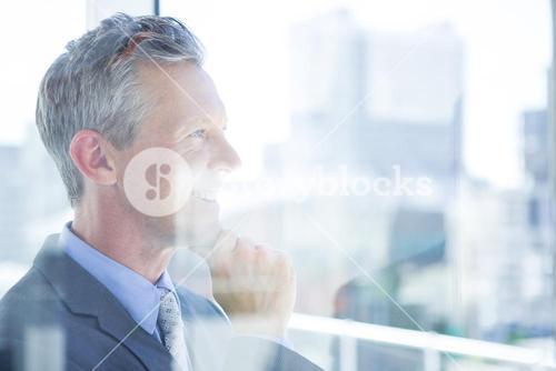 Thinking businessman in the office