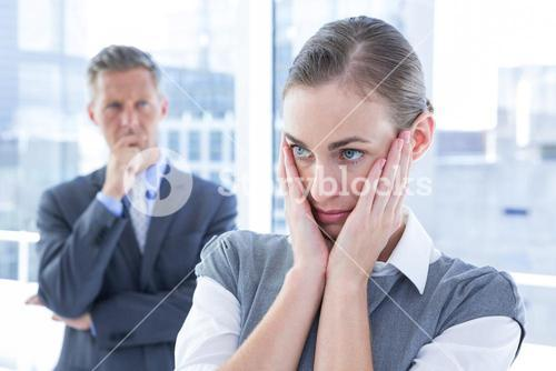 Businesswoman with hands on her face