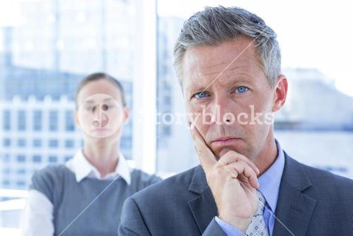 Puzzled businessman in the office