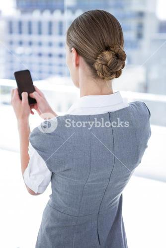 Businesswomen texting with his smartphone