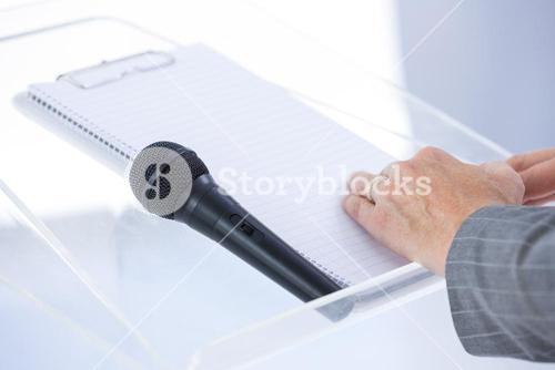 Businessman taking notes at conference